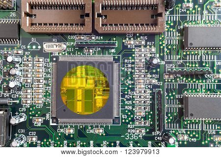 Green PCB close-up shot with cpu crystall insude