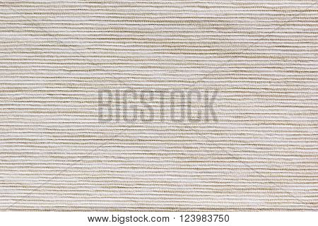 The beige texture cloth. The ribbed canvas. The background.