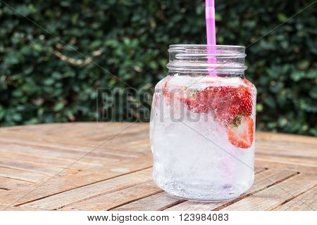 Glass of strawberry infused water, stock photo