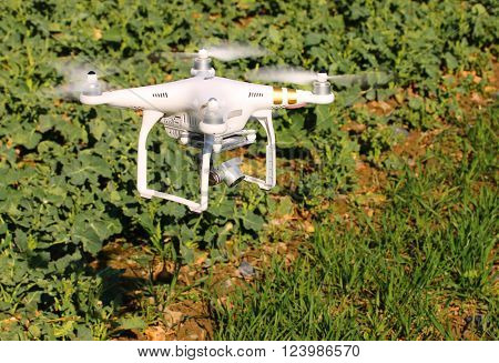 PILSEN CZECH REPUBLIC - MARCH 31, 2016: Drone quadrocopter Dji Phantom 3 Professional with camera. New tool for farmers use drones to inspect of cultivated fields. Modern technology in agriculture.