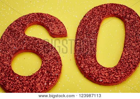 Number sixty red color over a yellow background. Anniversary. Horizontal