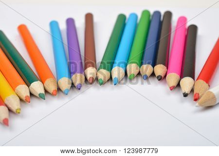 Close Up Picture Of Many Little Colored Pencil Crayons On White Background. Assortment Of Sharpened