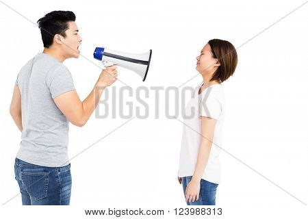 Angry man shouting at young woman on megaphone on white background