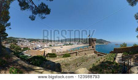 TOSSA DE MAR, CATLONIA, SPAIN - JUNE 19: Resort vacationers are visiting town and Platja Gran beach near Vila Vella Enceinte on June 19, 2014 in Tossa de Mar, Costa Brava, Catalonia, Spain.