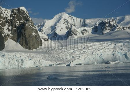 Glaciated Mountains And Icefall With Blue Sky
