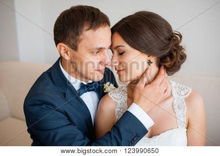 Wedding Couple Indoors Is Hugging Each Other.
