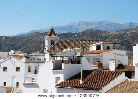 SAYALONGA, SPAIN - JULY 1, 2008 - View of the town and church with mountains to the rear Sayalonga Malaga Province Andalusia Spain Western Europe, July 1, 2008.