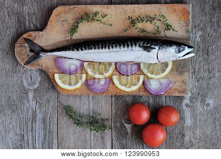 Raw mackerel with tomatoes and chopped onions and lemon.