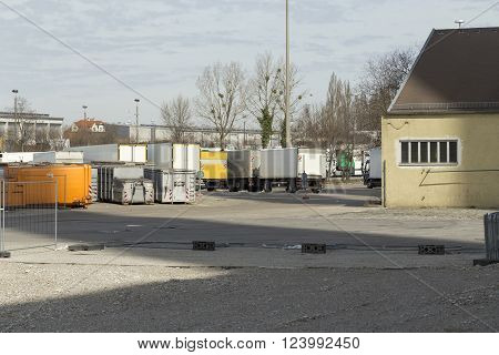 A trailer parking with some lorrys and containers