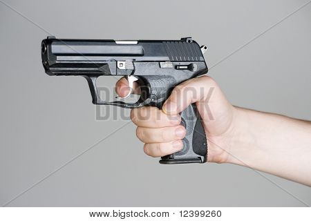 handgun in the hand