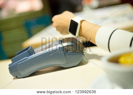 Smartwatch paying on the bill in restaurant
