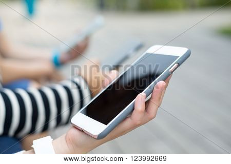 Group of people using cellphone together
