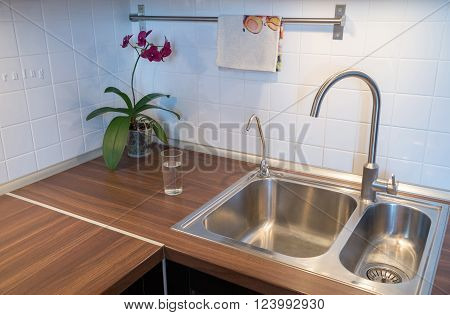cup of water on countertop in modern kitchen