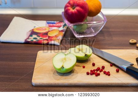 fresh apple and berries on countertop in kitchen