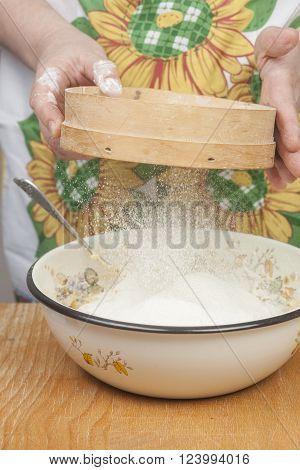 Women's Hands Preparing Flour Before Baking Pie