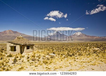 small village, several huts, in bolivia near snow covered volcanos near  Sajama in altiplano desert