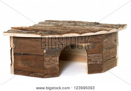wood shelter for rodent in front of white background