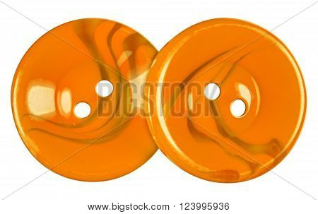 Orange Plastic buttons isolated on white with Clipping Path