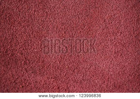 Natural vintage rose color suede texture as background.