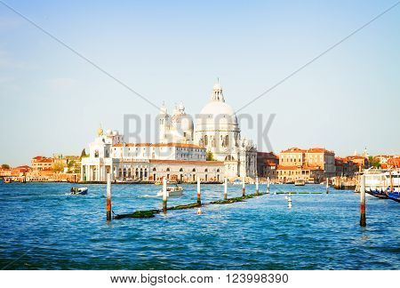 Basilica Santa Maria della Salute over  Grand canal water at sunny day, Venice, Italy, retro toned