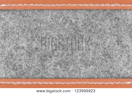 Background of close up on gray fabric texture and brown leather on the edges