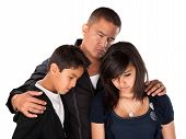 image of threesome  - Hispanic father with kids looking down and sad on white background - JPG