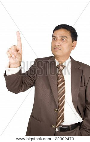 Portrait Of Mature Businessman Drawing Chart.