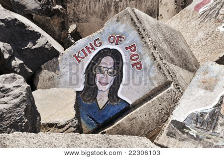 SANTA CRUZ DE TENERIFE, SPAIN - JUNE 18: A Michael Jackson graffiti on a stone of a breakwater on June 18, 2011 in Santa Cruz de Tenerife, Spain. Tribute to the King of Pop, died on June 25, 2009.