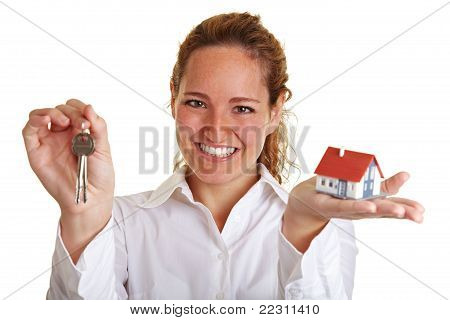 Happy Realtor Woman With House And Keys