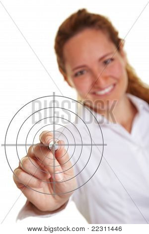 Business Woman Holding Pen To Crosshair