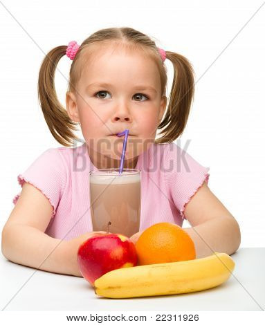 Little Girl Drinks Fruit Juice