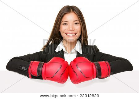 business woman sign - boxing gloves. Businesswoman boxer in suit showing blank empty paper poster billboard sign smiling happy. Beautiful Asian / Caucasian young female professional isolated on white