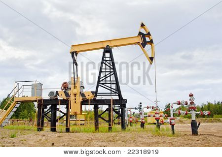 Pump Jack And Oil Well.