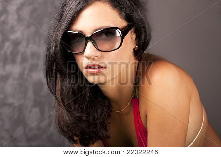 Attractive young lady in sun glasses