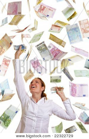 Happy Business Woman Catching Falling Money