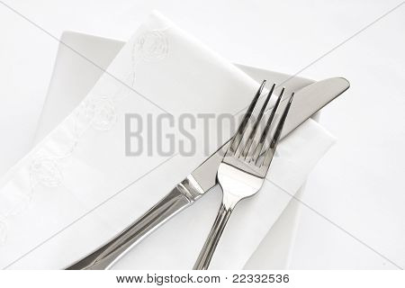 Fork, Knife And White Napkin Table Setting