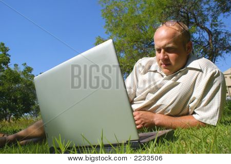 Man With Laptop In Park