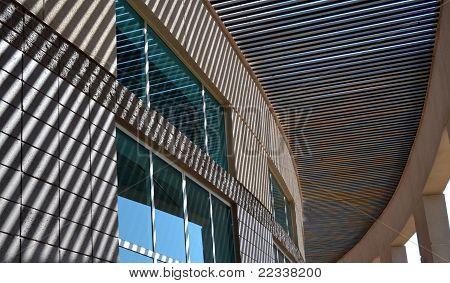 Curved Facade With Striking Diagonal Shadows