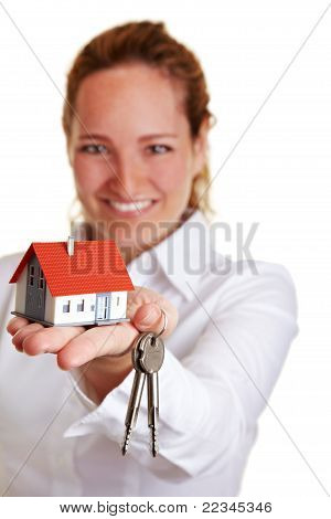 Realtor Woman Offering House Keys And House