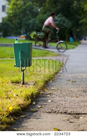 City Garbage Bin And Cyclist