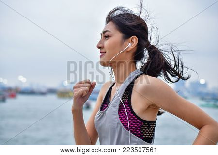 poster of Sports concept. Beautiful girl is exercising on the beach with running. Beautiful girl is happy to exercise.  Beautiful girls like to exercise by running. People are exercising on the beach.