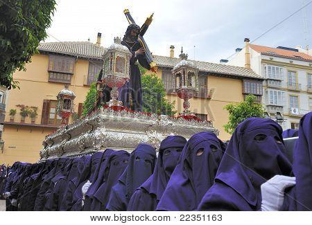 Costaleros Bearing A Tronos During Semana Santa In Malaga, Spain