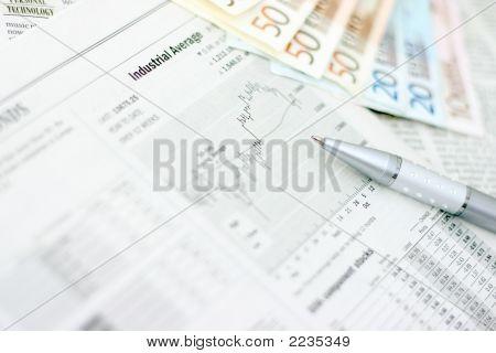 Money And Newspaper