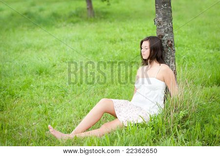 Outdoor Portrait Of A Cute Resting Teen