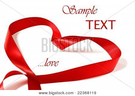 Heart shaped red satin ribbon on white background with copy space.  Macro with shallow dof.