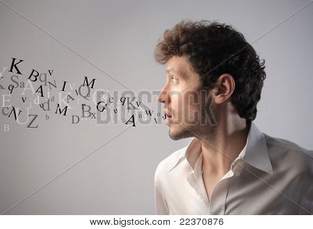 Young man talking with alphabet letters coming out of his mouth