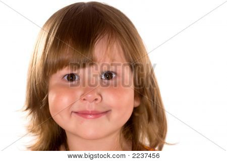 Studio Portrait Of A Pretty Smiling Girl