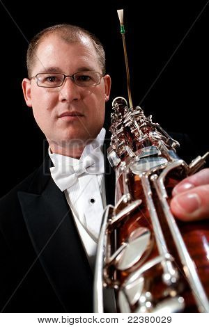 Serious Caucasian Male Holding Bassoon
