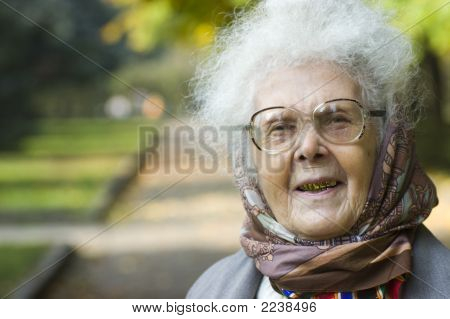 Laughing Elderly Woman In Park