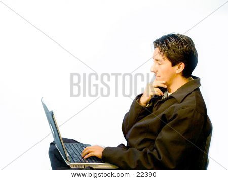 Young Man On Laptop